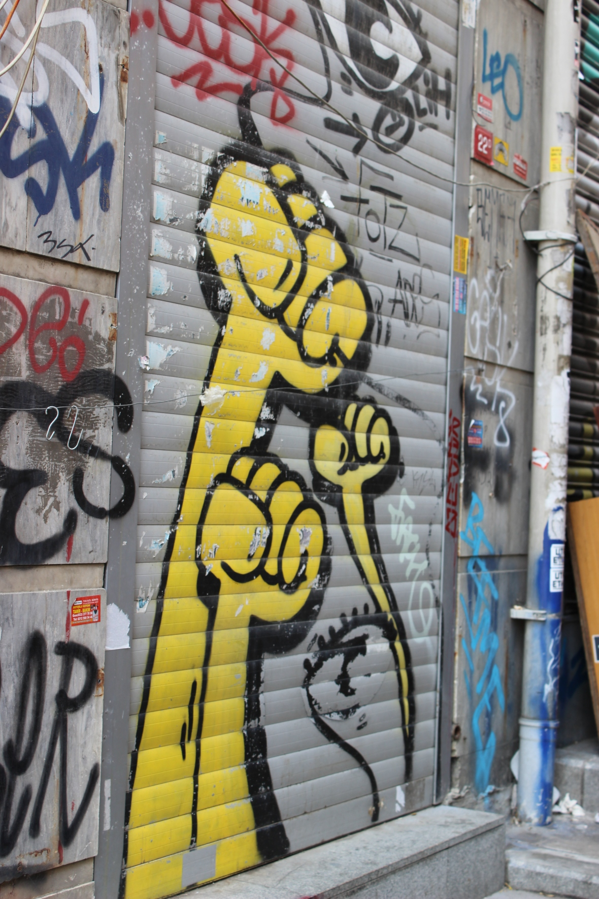 Yellow Fists by Berlin Artist